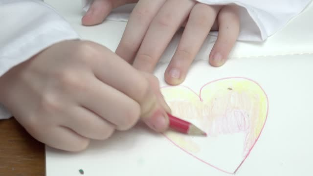 Girl Play Drawing Heart Close Up video