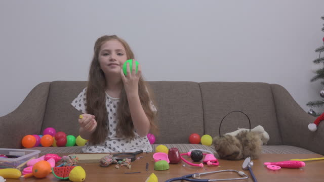 Girl Play Green Ball On Sofa video