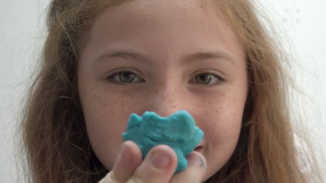 Girl Play With Clay Look At Camera video