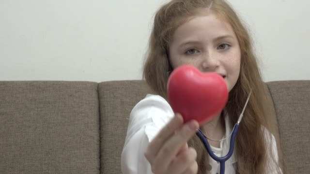 Girl Play With Red Heart Ball video