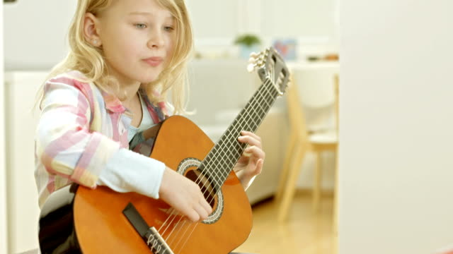 Girl Playing An Acoustic Guitar video