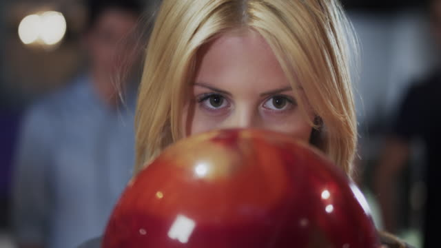 Girl playing Bowling video