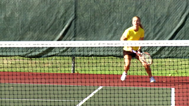 Girl playing tennis in slow motion video