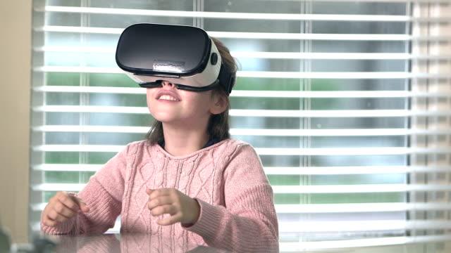 Girl playing virtual reality game video