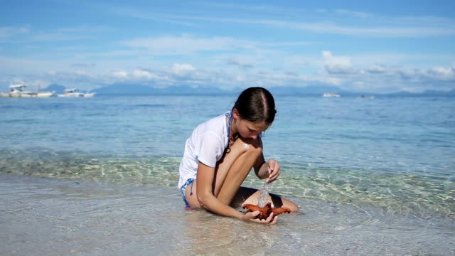 Girl playing with a starfish video