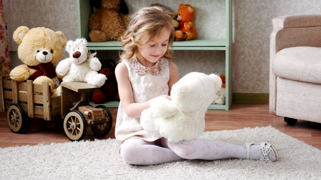 girl playing with a toy bear 4k