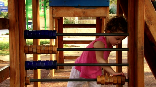 Girl playing with abacus video