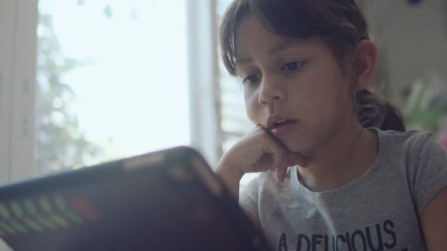 girl playing with digital tablet - 8 9 anni video stock e b–roll