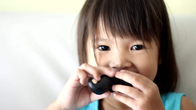 girl playing with fake mustache video