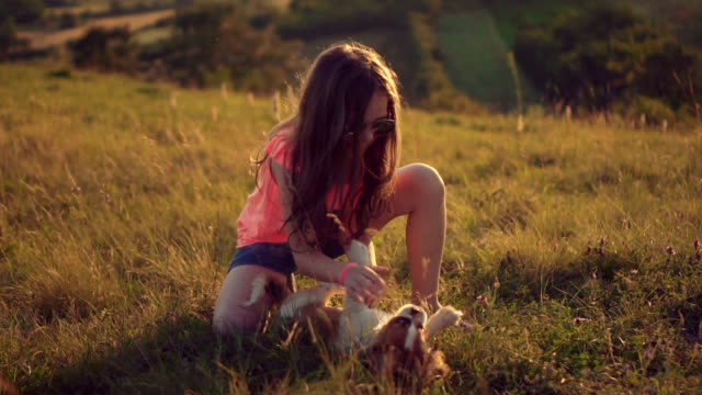 Girl playing with her puppy video