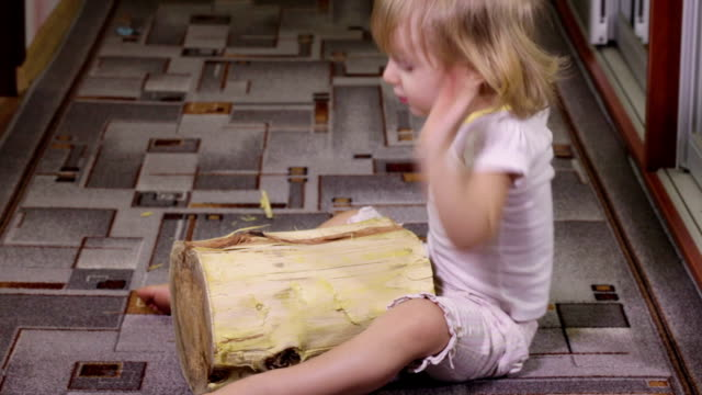 Girl playing with log video