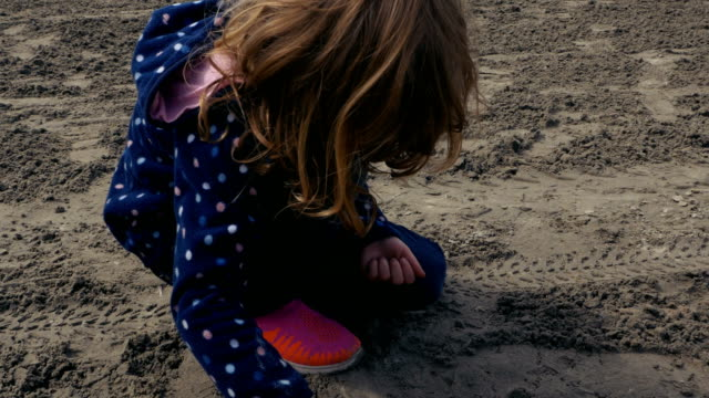 Girl Playing With Wet Sand video