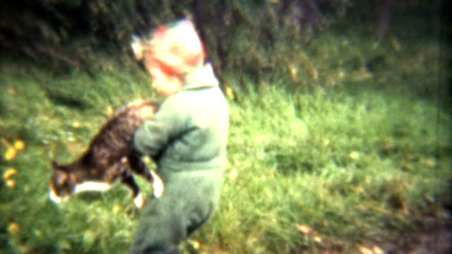 Girl Plays With Cats And Dogs (1941 Vintage 8mm) video