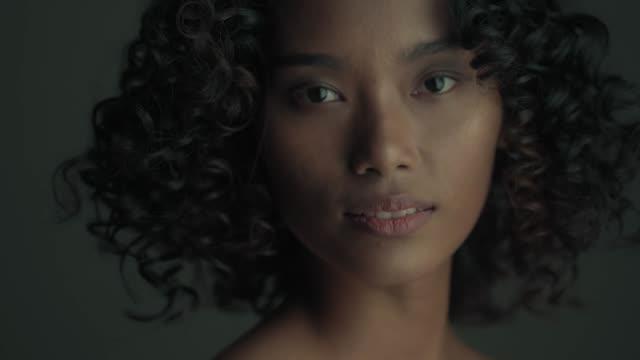 Girl power  : Asian Afro Women Low Key Attitudes low lighting stock videos & royalty-free footage
