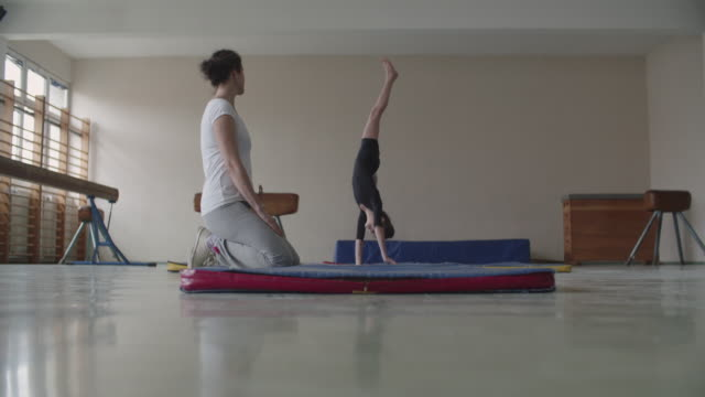 4K: Girl practicing gymnastics video