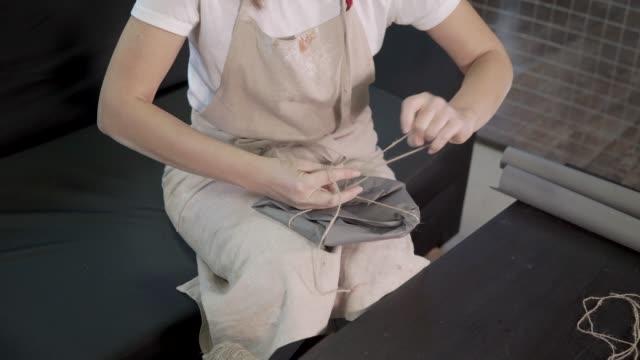 Girl preparing a present for her friend