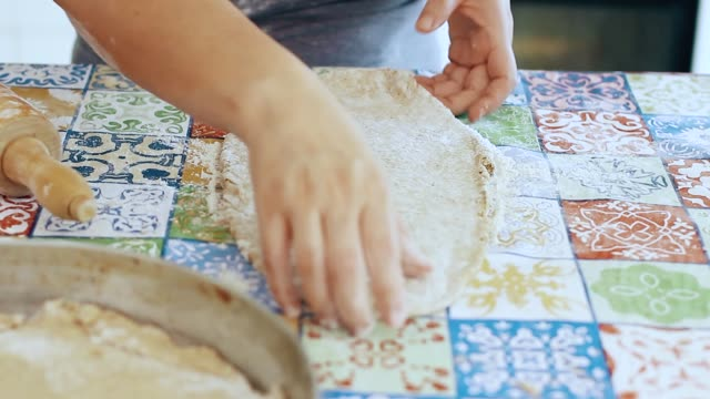 girl preparing a wholemeal pizza dough
