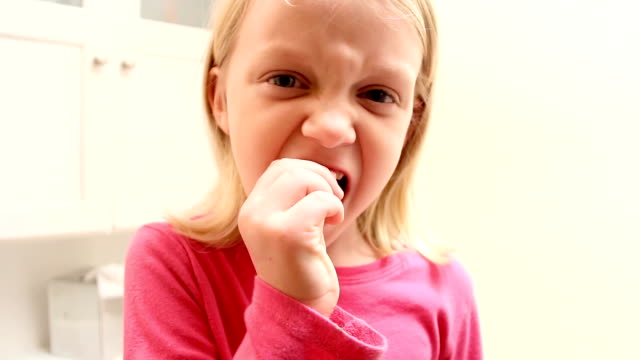 Girl Pulls a Tooth Out video