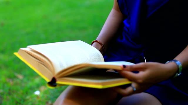girl read book at public park
