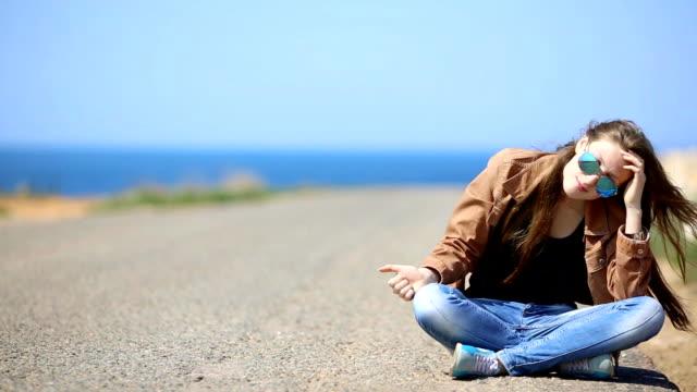 girl resting on the roadside video