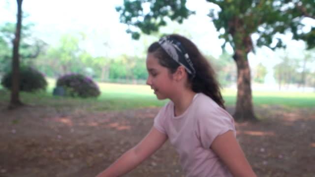 girl riding skateboard in the park