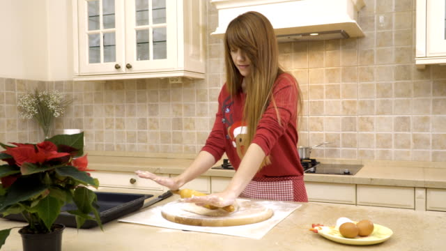 Girl rolls a dough with a rolling pin video