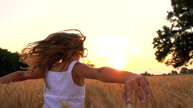 HD SUPER SLOW-MOTION: Girl Running In Field At Sunset video