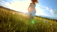 istock SUPER SLO-MO Girl Running In The Meadow At Sunset 493319015
