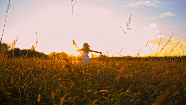 SLO MO Girl Running With Outstretched Arms At Dusk video