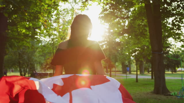 girl running with the canadian flag - canada flag stock videos & royalty-free footage