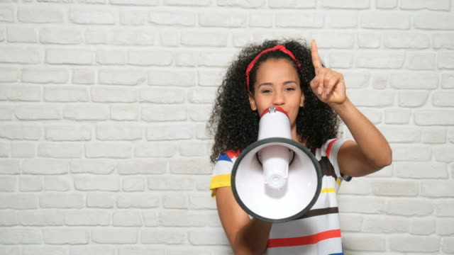 Girl Shouting Screaming Yelling With Megaphone For Promotion Advertising Happiness Young people, feelings and emotions. Portrait of happy african american woman shouting with megaphone for promotion, advertising. Black girl smiling and laughing for fun, joy, happiness megaphone stock videos & royalty-free footage