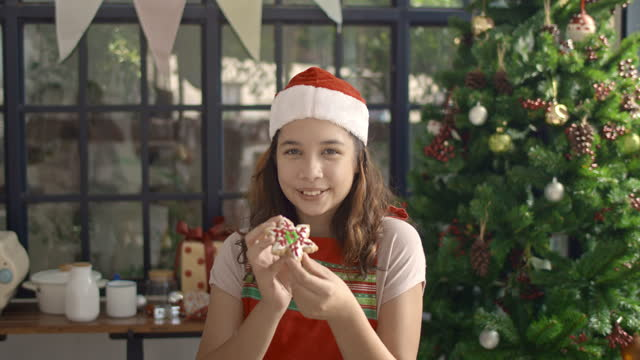 Girl showing Christmas cookies,Slow motion