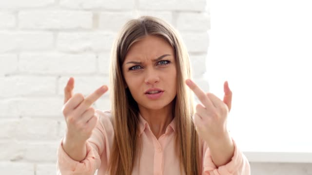 Girl Showing Middle Finger in Anger Woman Showing Middle Finger in Anger middle finger stock videos & royalty-free footage