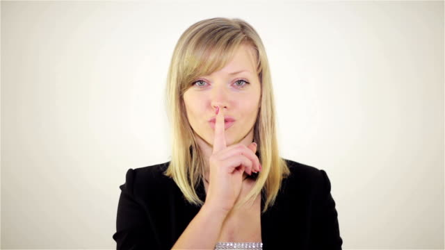 A girl shows a gesture of silence video