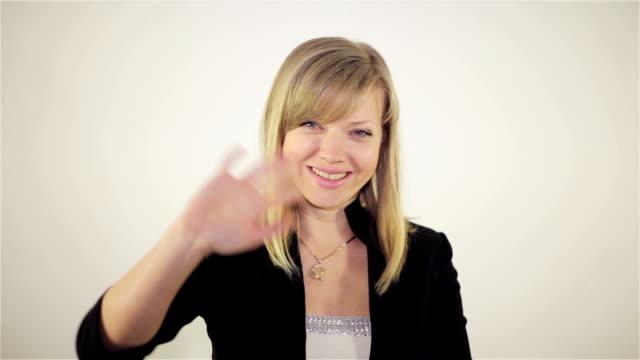 Girl shows gesture greetings video
