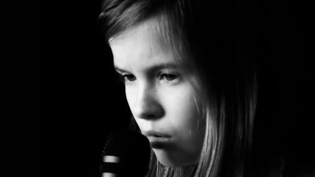 Girl sings a song video