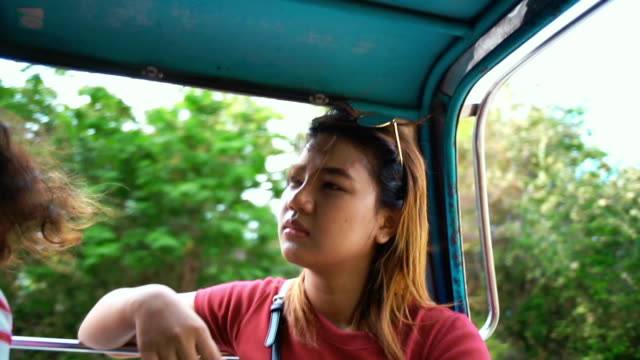 Girl sitting in open air van slowmotion video