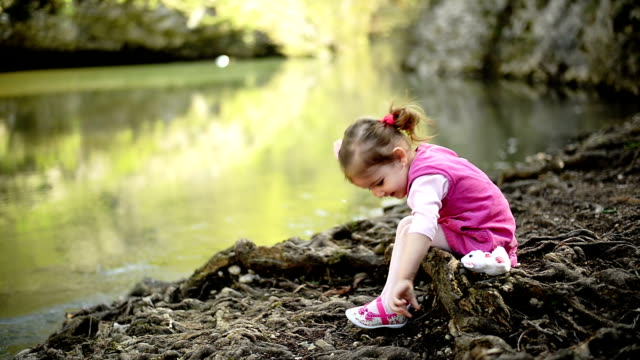 Girl sitting near the river video