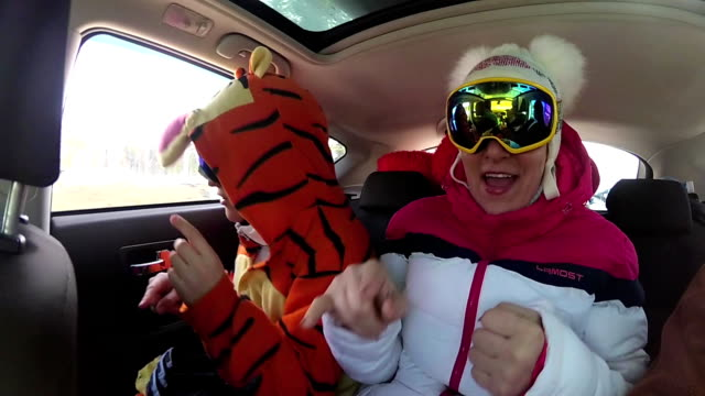 girl skier having fun with the music in the car on the trip video