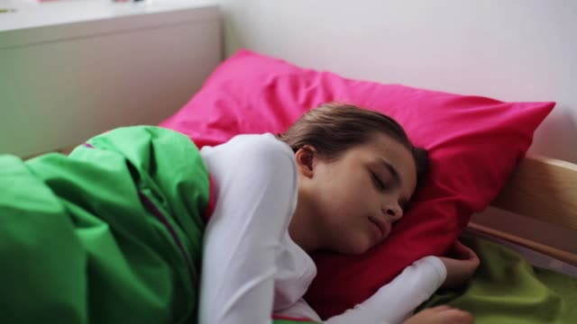girl sleeping in her bed at home - preadolescente video stock e b–roll
