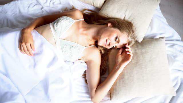 girl sleeping in lingerie in bed woke up in the morning video