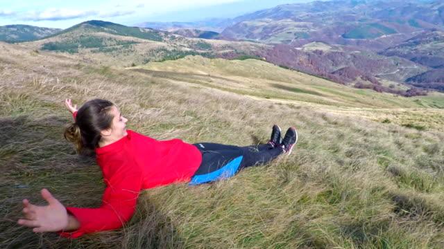 Girl sliding down the hill 4K video