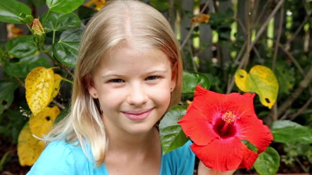 Girl Smelling Flower video