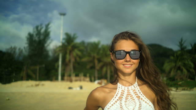 Girl Smiling At Beach, American Flag In Sunglasses video