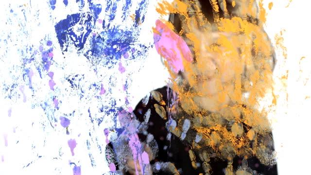 HD: Girl Splashing Color On A Glass video