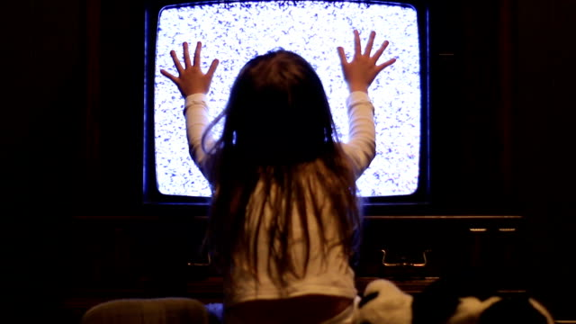 Girl stares at white noise television Little girl stares at eerie TV screen as in the iconic movie ghost icon stock videos & royalty-free footage