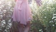 istock Girl stroll in daisy flower garden 1198985006