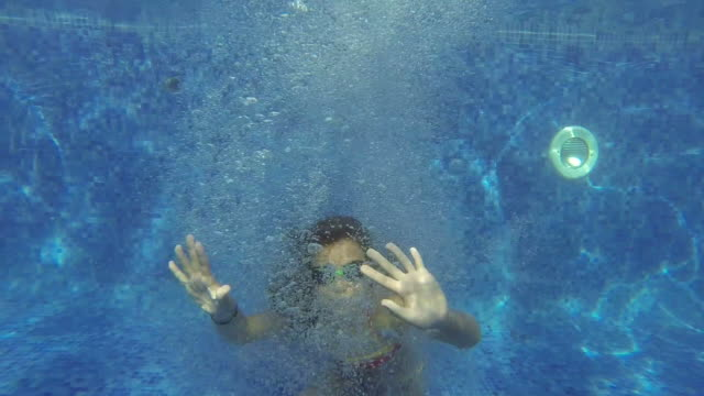 Girl swimming underwater video