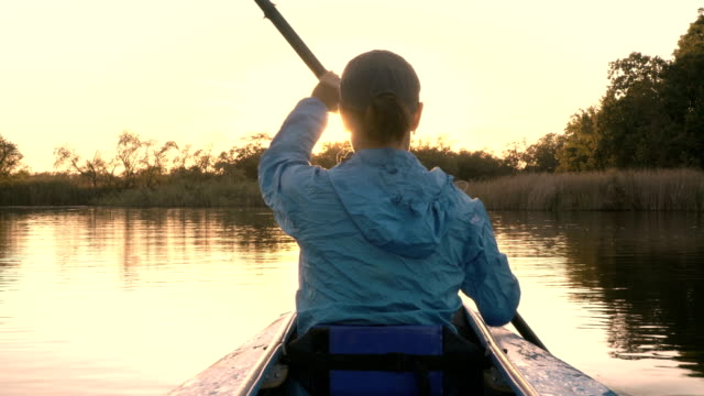 Girl swims in the kayak in the sunset video