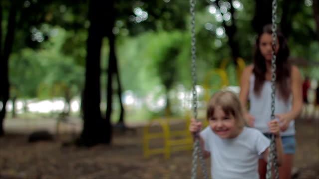 Girl swinging on a swing video
